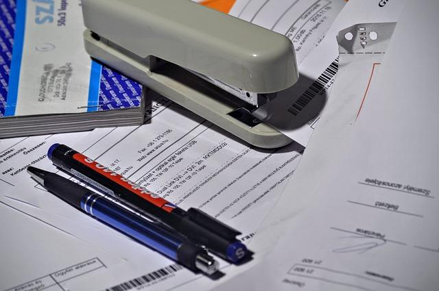 stapler, pen, paperwork